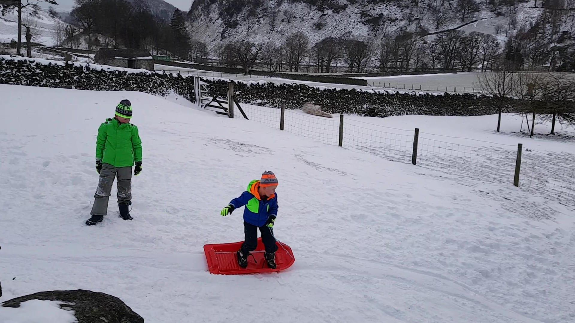 Boys sledging